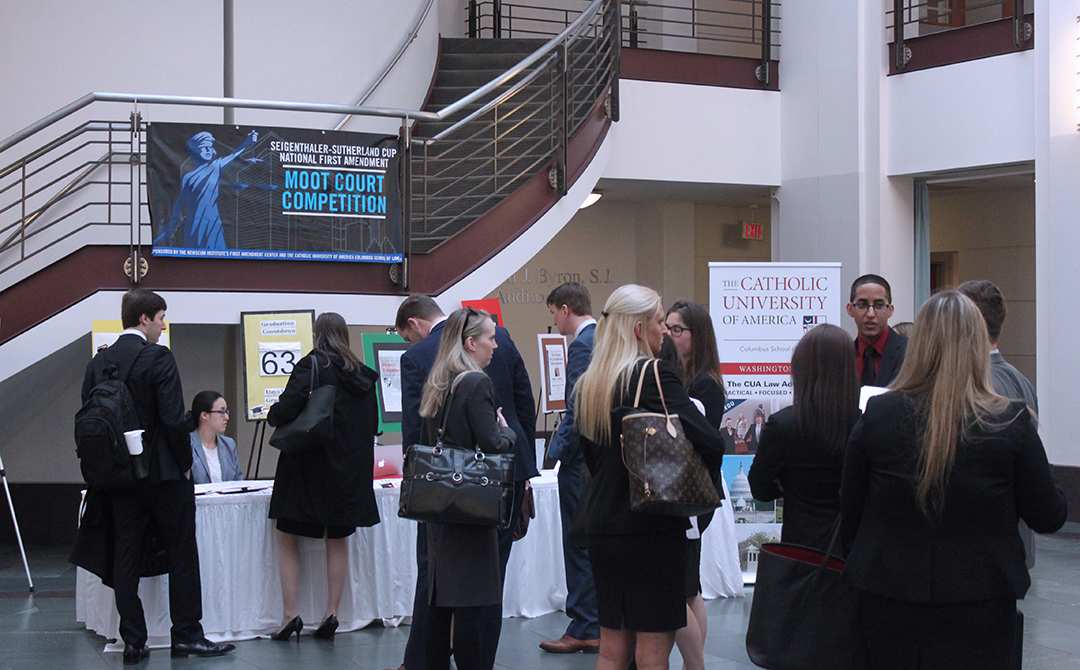 competitors registering for the Sutherland cup in the law school atrium