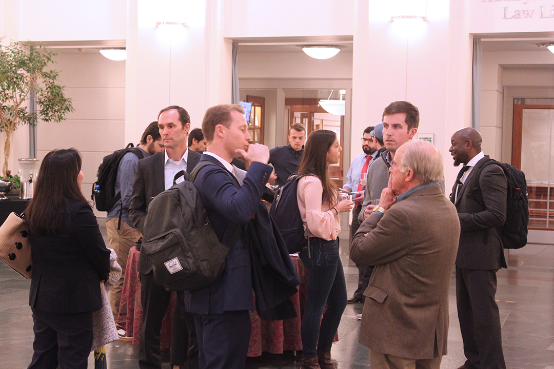 Group of students and alumni networking in the law school atrium
