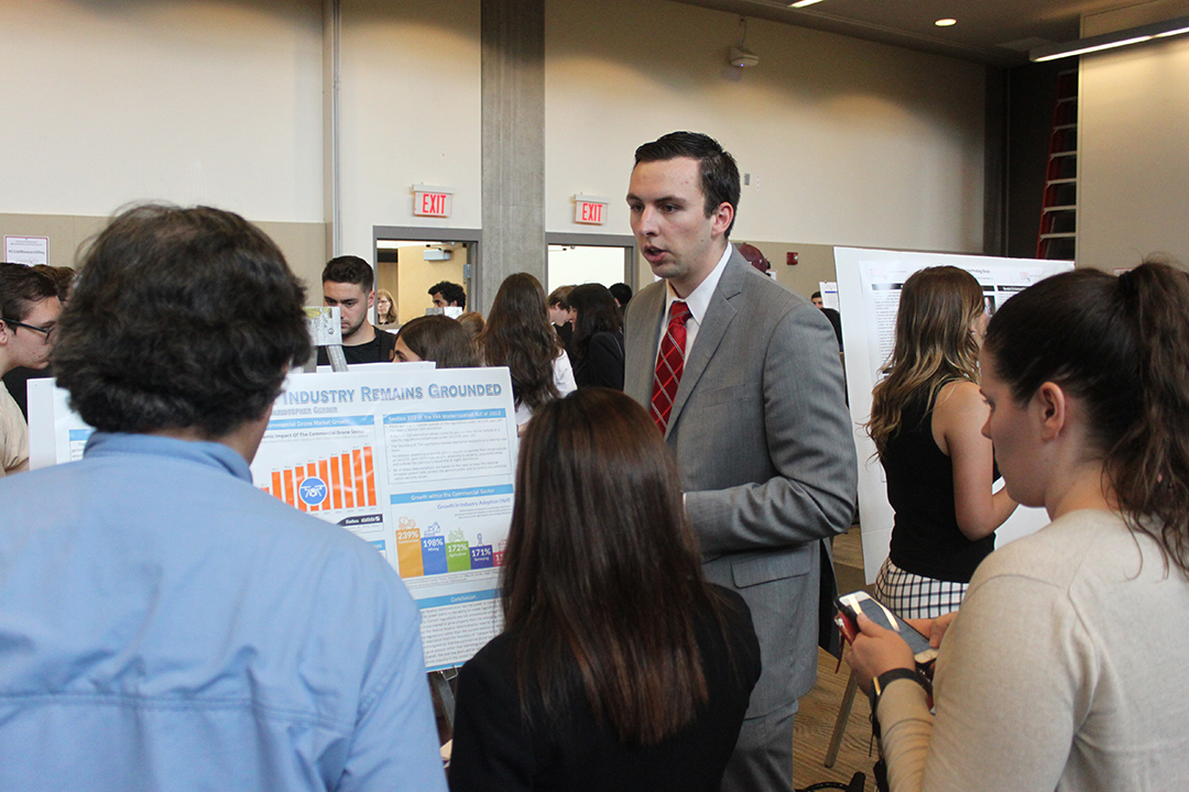 student speaking at CUA Research day